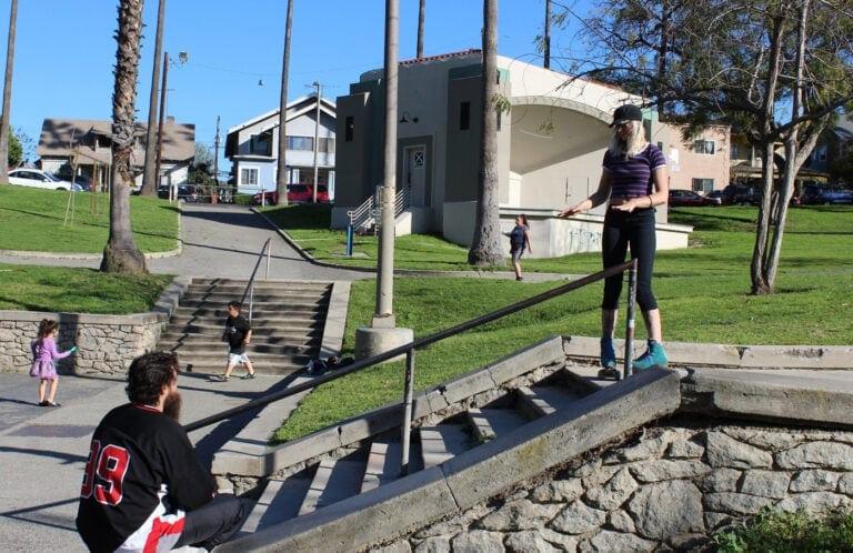 Roller skater talks to her filmer about filming a skate trick.